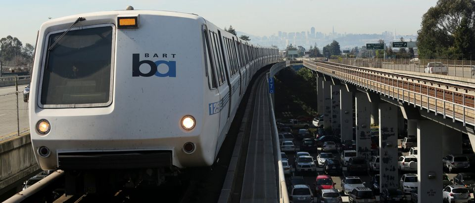 A Bay Area Rapid Transit (BART) train enters the platform area at the Rockridge station in Oakland