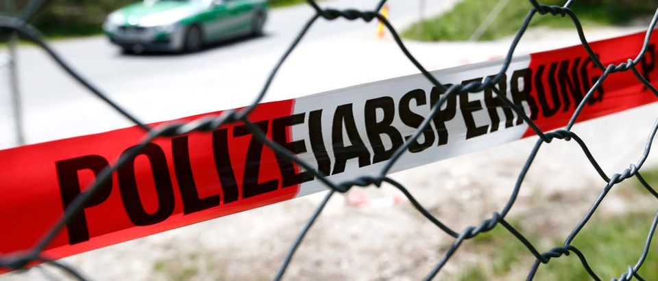 Police warning tape is seen at fence near hotel castle Elmau in Kruen
