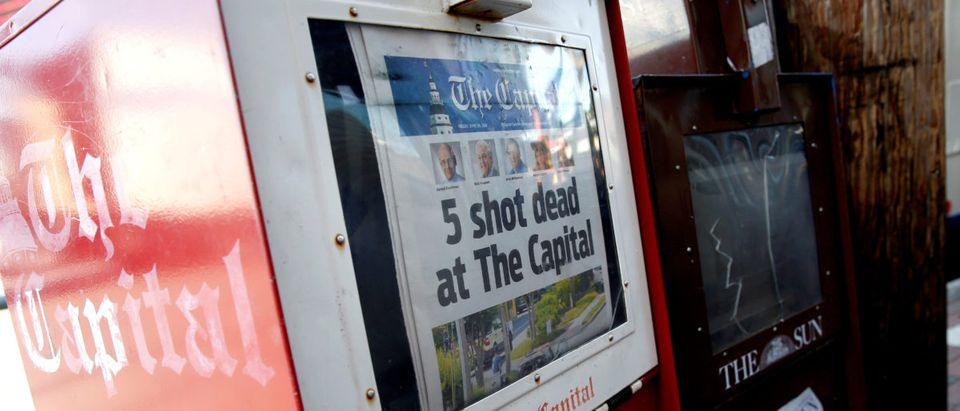 A copy of the Capital Gazette is displayed in a newspaper box the day after a gunman killed five people and injuring several others at the publication's offices in Annapolis, Maryland, U.S., June 29, 2018. REUTERS/Joshua Roberts