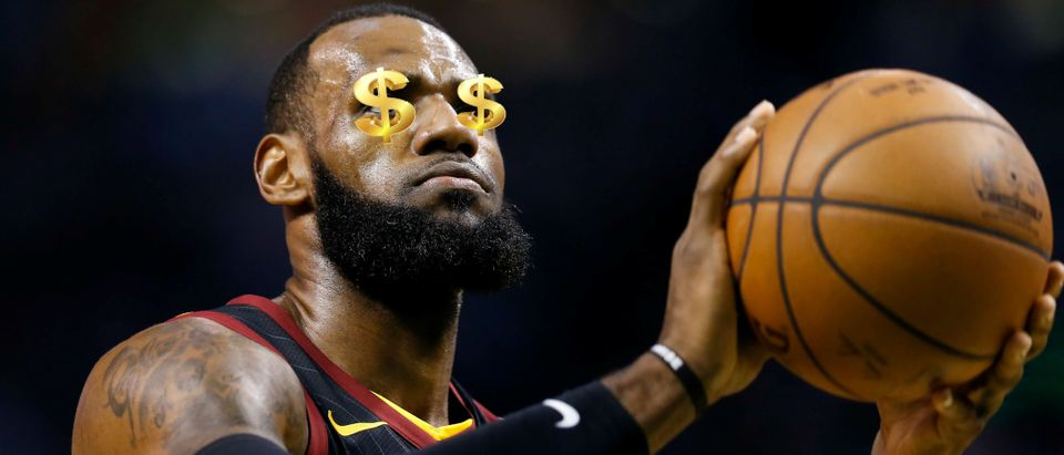 Cleveland Cavaliers forward LeBron James (23) attempts a free throw against the Boston Celtics during the first quarter of game five of the Eastern conference finals of the 2018 NBA Playoffs at TD Garden. Mandatory Credit: Greg M. Cooper-USA TODAY Sports and tassel78, Shutterstock