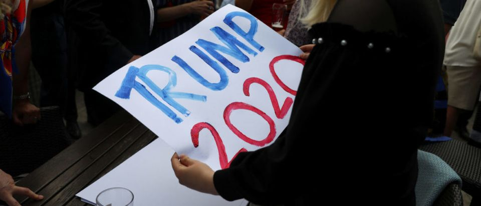 An attendee writes a placard ahead the visit to the United Kingdom of Donald Trump the President of the United States at a Republicans Overseas event in London