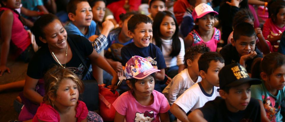 Migrant children from Central America, moving in a caravan through Mexico toward Mexico City, participate in a puppet show at a temporary shelter set up for them by the Catholic church, in Puebla