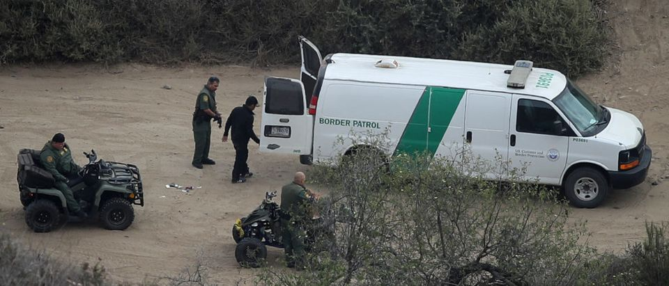 Man is apprehended by border patrol after he illegally crossed into the U.S. from Mexico near San Diego, California