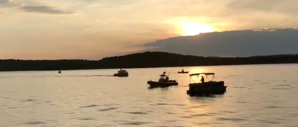 """Rescue personnel work after an amphibious """"duck boat"""" capsized and sank, at Table Rock Lake near Branson, Stone County, Missouri, U.S. July 19, 2018 in this still image obtained from a video on social media. SOUTHERN STONE COUNTY FIRE PROTECTION DISTRICT/Facebook/via REUTERS"""