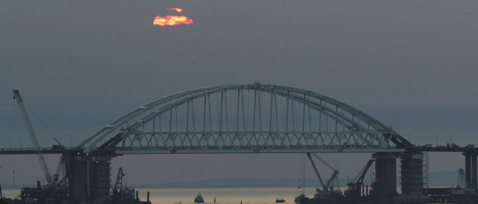 FILE PHOTO: A general view shows a road-and-rail bridge, which is constructed to connect the Russian mainland with the Crimean peninsula, during sunrise in the Kerch Strait, Crimea April 14, 2018. REUTERS/Pavel Rebrov/File Photo