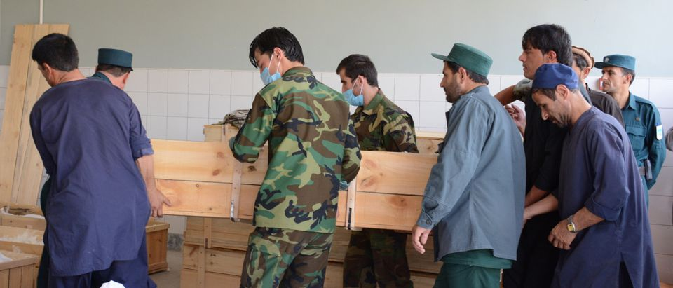 Afghan security forces carry a coffin of their comrade after he was killed during a battle with the Taliban, at a hospital in Takhar province, Afghanistan July 12, 2018. REUTERS/Stringer NO RESALES. NO ARCHIVES - RC14332D5DC0
