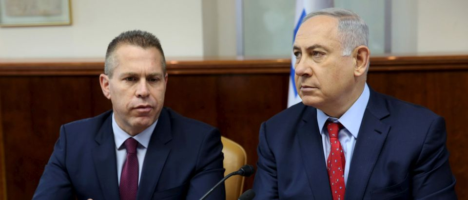 FILE PHOTO: Israeli Prime Minister Netanyahu sits next to Israeli Public security Minister Erdan during the weekly cabinet meeting in Jerusalem