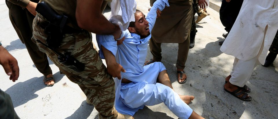 A man reacts after an attack in Jalalabad city, Afghanistan