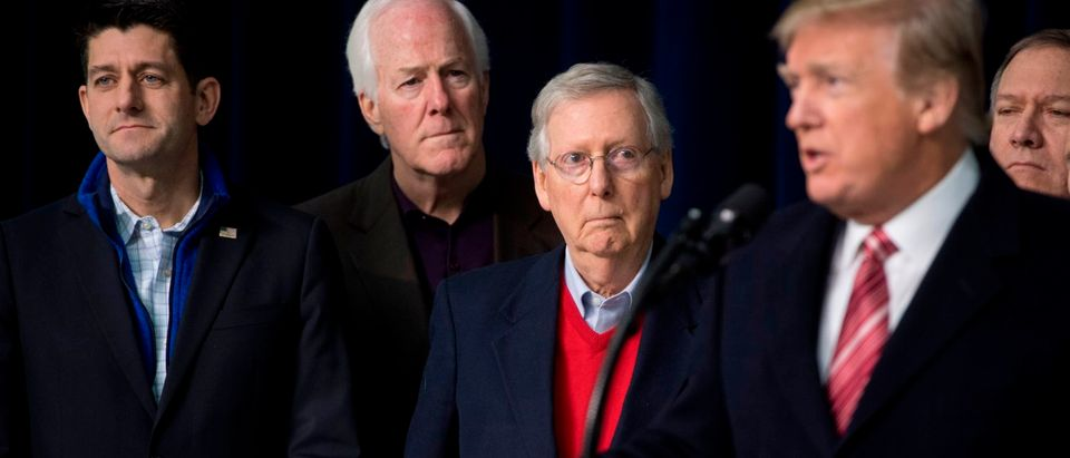 President Trump alongside Paul Ryan, John Cornyn and Mitch McConnell (C) during a retreat with Republican lawmakers Jan. 6, 2018. / AFP PHOTO / SAUL LOEB / Getty Images