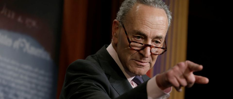 Senate Minority Leader Chuck Schumer gestures at a news conference