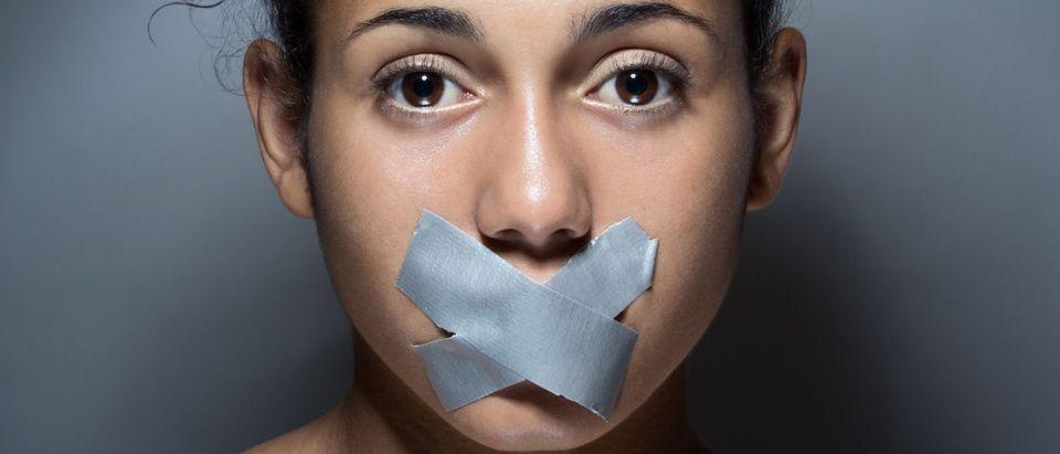 Silenced Woman (Shutterstock/Josep Suria)