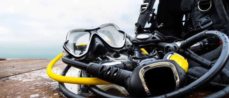Snorkeling equipment for driving on wood platform -- ShutterStock -- Prextimize