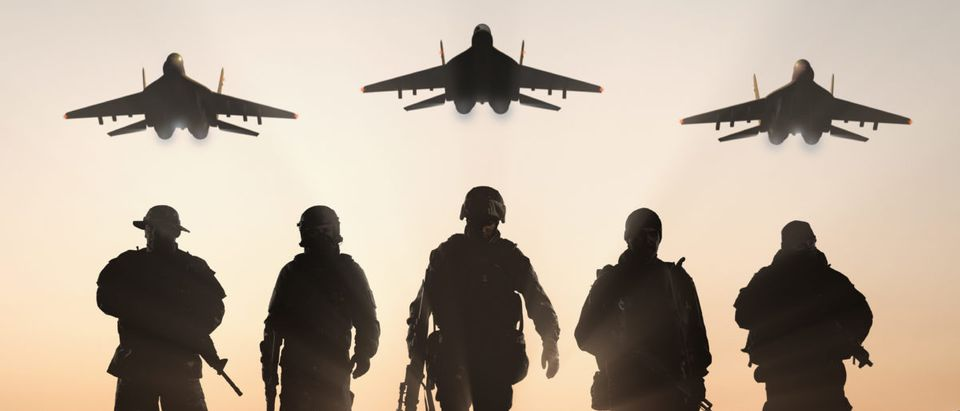 Soldiers are pictured with airplanes overhead.(Shutterstock/BPTU)