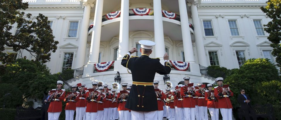 The Marine Band performs at a Fourth of July barbeque hosted by US President Barack Obama and First Lady Michelle Obama for military members and families and government employees and families July 4, 2010 on the South Lawn of the White House in Washington, DC. (Photo credit MANDEL NGAN/AFP/Getty Images)