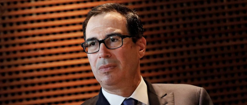 U.S. Treasury Secretary Steven Mnuchin listens to a question during an interview with Reuters in Sao Paulo