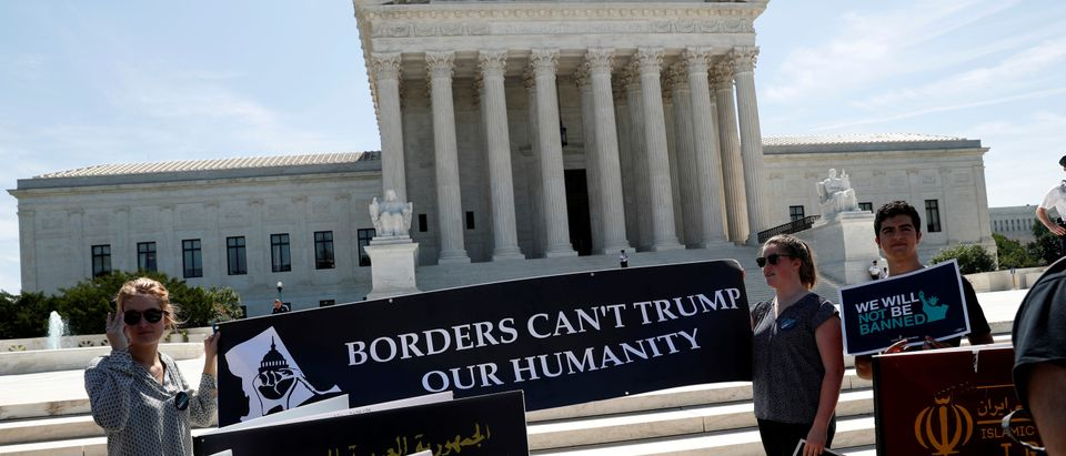 Immigration rights proponents demonstrate outside the U.S. Supreme Court in Washington, U.S., June 26, 2018. REUTERS/Leah Millis