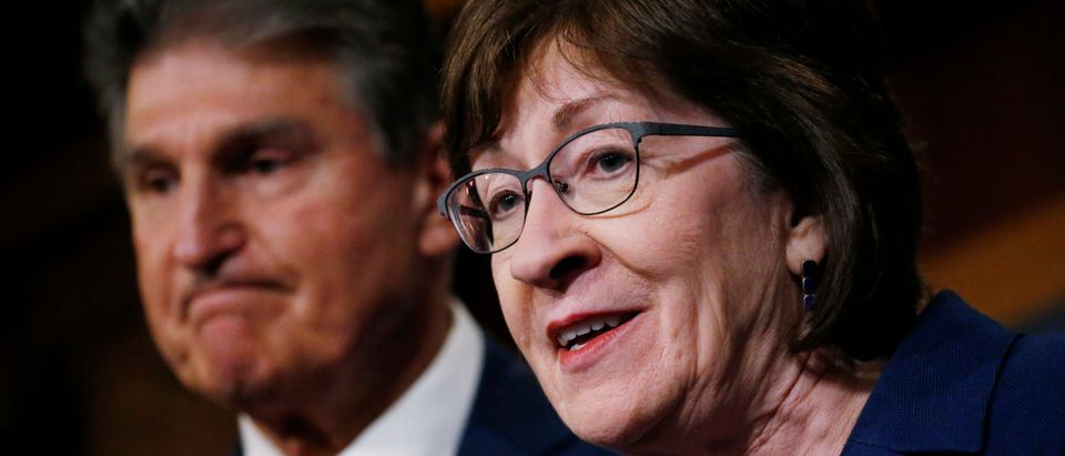 U.S. Senators' Susan Collins (R-ME) and Joe Manchin (R-WV) brief reporters after lawmakers struck a deal to reopen the federal government three days into a shutdown on Capitol Hill in Washington, U.S., January 22, 2018. REUTERS/Leah Millis