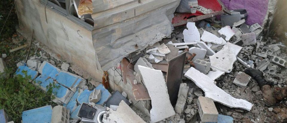 Damages and a body part are seen after suicide bomb attack in Sweida