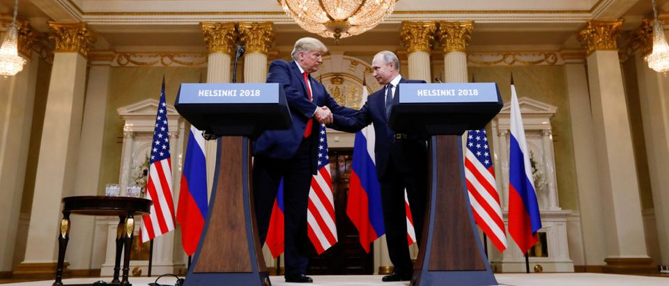 U.S. President Donald Trump and Russia's President Vladimir Putin shake hands during a joint news conference after their meeting in Helsinki, Finland, July 16, 2018. REUTERS/Kevin Lamarque/File Photo