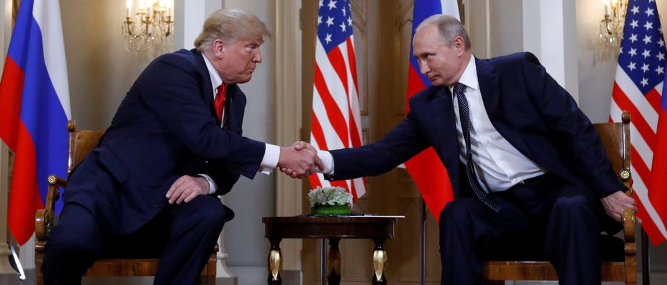 U.S. President Donald Trump and Russia's President Vladimir Putin shake hands as they meet in Helsinki, Finland July 16, 2018. (REUTERS/Kevin Lamarque)