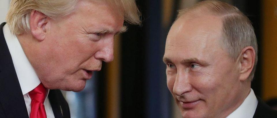 Trump and Putin AFP/Getty Images/Sputnik/Mikhail Klimentyev