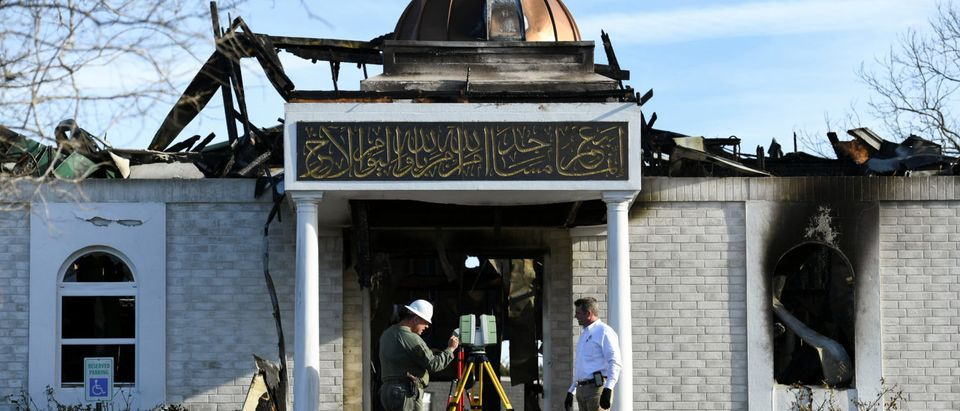 Security officials investigate the aftermath of a fire at the Victoria Islamic Center mosque in Victoria, Texas January 29, 2017. REUTERS/Mohammad Khursheed