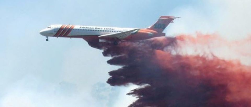 A plane drops fire-retardant chemicals on the 416 Fire near Durango, Colorado, U.S. in this June 9, 2018 handout photo. La Plata County/Handout via REUTERS