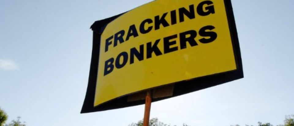 "An anti-fracking sign is displayed at the protest camp by the entrance to a site run by Cuadrilla Resources, outside the village of Balcombe in southern England August 6, 2013. Protesters have been blocking access to a drilling site in southern England as part of a campaign against the controversial ""fracking"" process used in shale gas exploration, illustrating the potential battle ahead for Britain's nascent shale industry. REUTERS/Luke MacGregor"