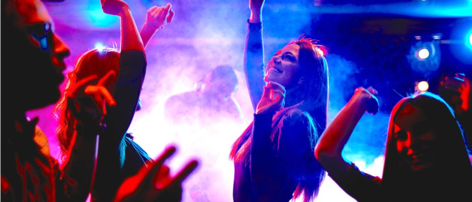 Group of women dancing in the club (Shutterstock/ Pressmaster)