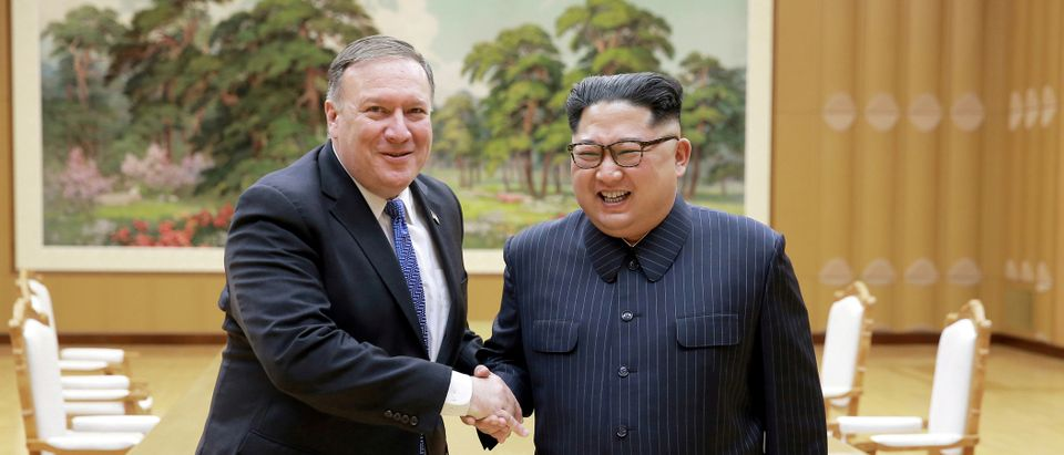 FILE PHOTO: North Korean leader Kim Jong Un shakes hands with U.S. Secretary of State Mike Pompeo in this May 9, 2018 photo released on May 10, 2018 by North Korea's Korean Central News Agency (KCNA) in Pyongyang. KCNA/via REUTERS