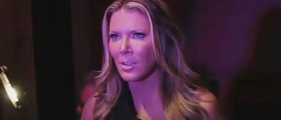 Fox host Trish Regan sings the national anthem./Screenshot