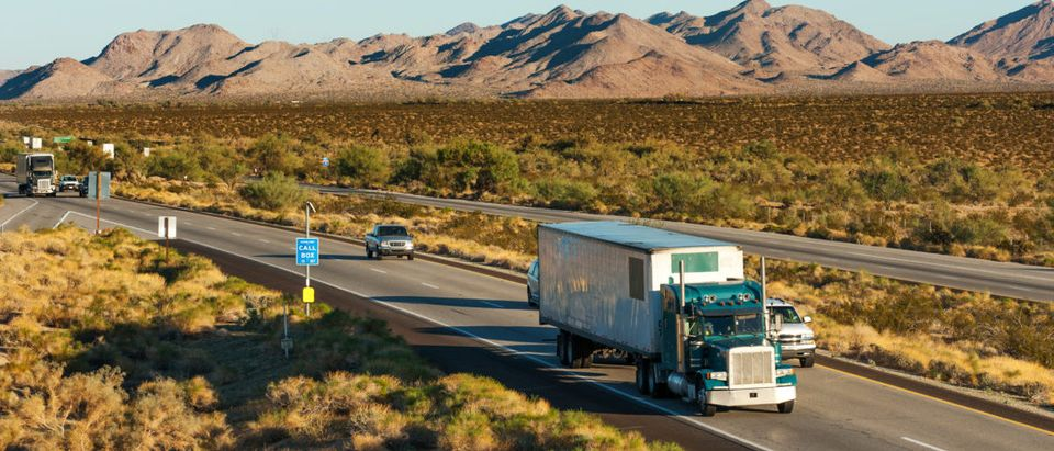 Traffic is moving across America on interstate I-10, Arizona. SHUTTERSTOCK/ Natalia Bratslavsky