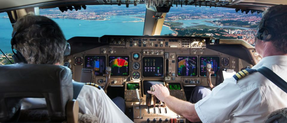 The cockpit of a modern jet airplane is pictured. (Skycolors/Shutterstock)