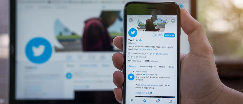 CHIANG MAI, THAILAND - JUNE 24, 2017: Person holding a brand new Apple iPhone with Twitter logo on the screen. Twitter is a social media online service for microblogging and networking communication. (Worawee Meepian/Shutterstock)