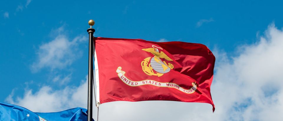 The United States Marine Corps flag flies in the wind. Shutterstock image via RRuntsch