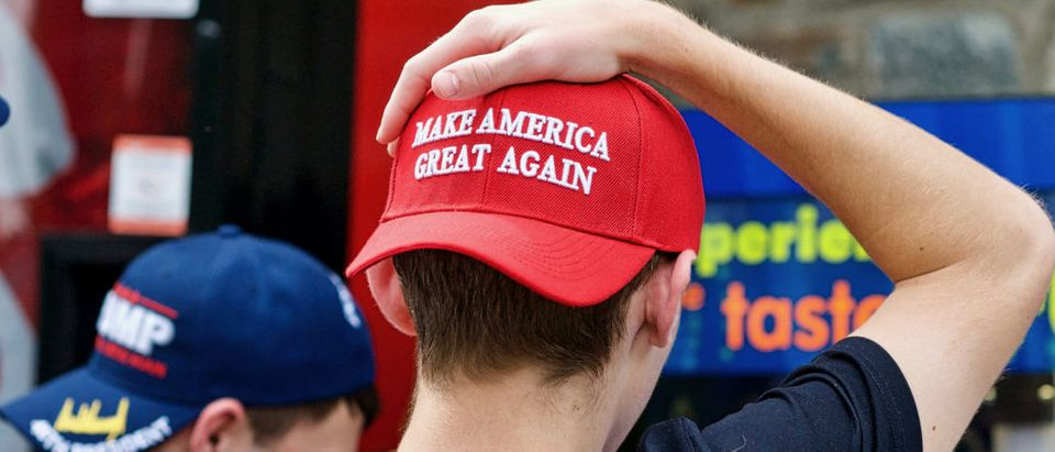 Washington, DC - October 6, 2017: Two unidentified men display their support for President Donald J. Trump through the hats they are wearing during a visit to the National Zoo.