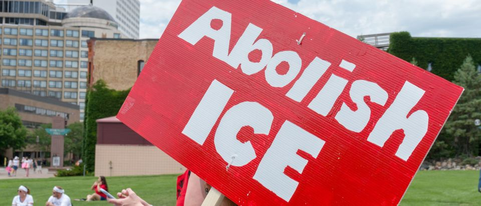 Pictured is an Abolish ICE sign. (Shutterstock/Ken Wolter)