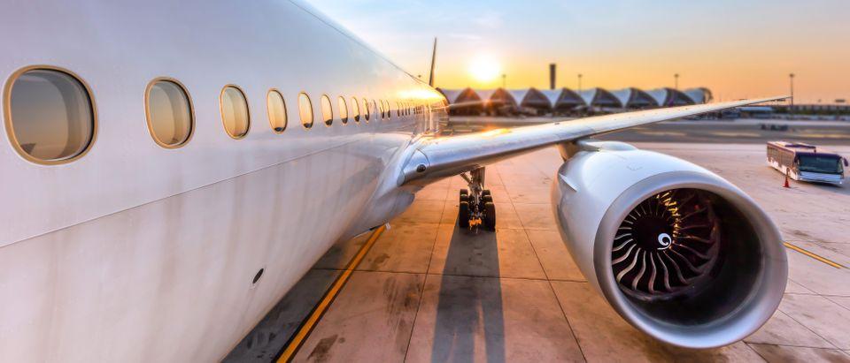 Airplane sitting on tarmac (Shutterstock/biggaju)