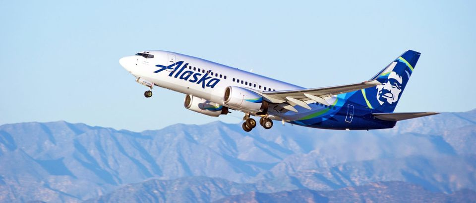 LOS ANGELES/CALIFORNIA - JANUARY 14, 2017: Alaska Airlines Boeing 737-790(WL) aircraft is airborne as it departs Los Angeles International Airport, Los Angeles, California USA [Shutters
