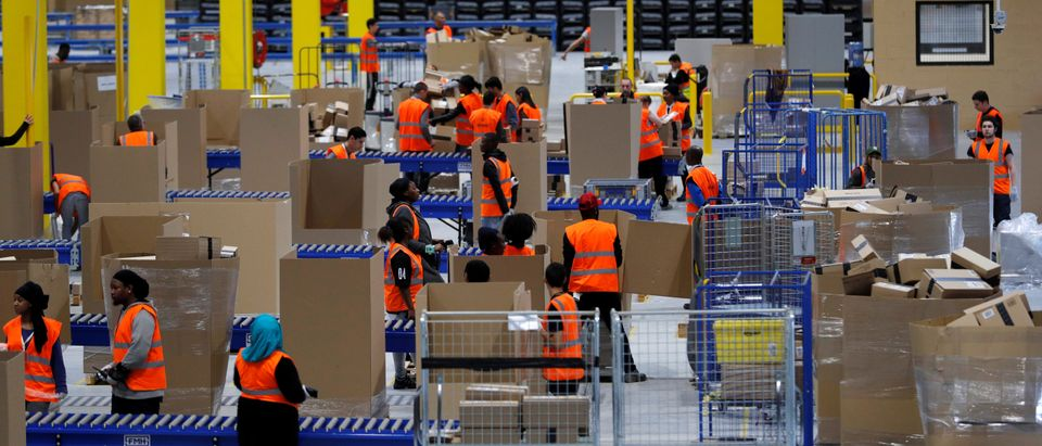 Employees work at the Amazon distribution center in Saran, near Orleans