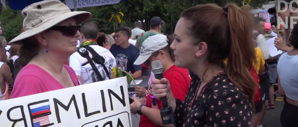 Anti-NRA protesters gathered together outside the National Rifle Association Headquarters in Fairfax, Virginia on Saturday for the March on NRA rally. (YouTube/TheDCNF)