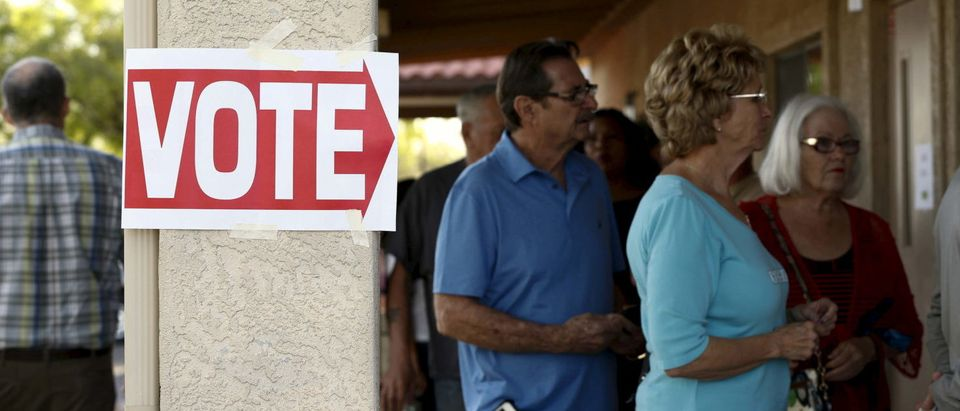 People wait to vote in the U.S. presidential primary election at a polling site in Arizona