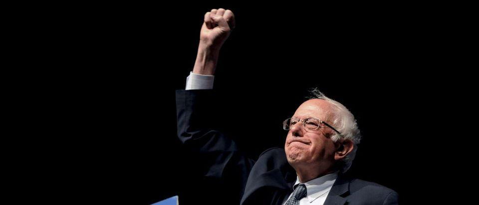 Democratic U.S. presidential candidate Sanders pumps his fist after announcing he won the Wisconsin primary at a campaign rally in Laramie, Wyoming