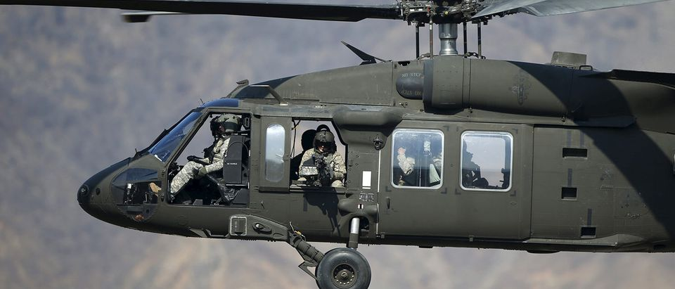 A U.S. Army soldier aims his weapon inside a U.S. Army Black Hawk helicopter as they take part in a U.S.-South Korea joint live-fire military exercise at a training field in Pocheon, south of the demilitarized zone separating the two Koreas, March 25, 2015. The exercise is part of Foal Eagle, an annual military training between U.S. and South Korea that runs from March 2 to April 24. REUTERS/Kim Hong-Ji