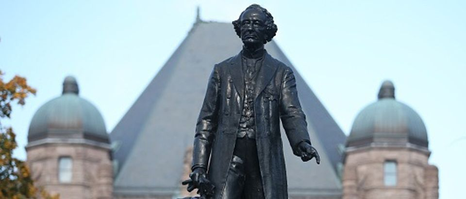 A statue of Sir John A Macdonald stands high in front of Queens Park