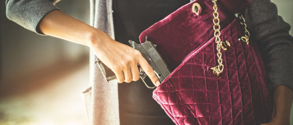 This woman conceal-carries a gun. (Shutterstock/Chayantorn Tongmorn)