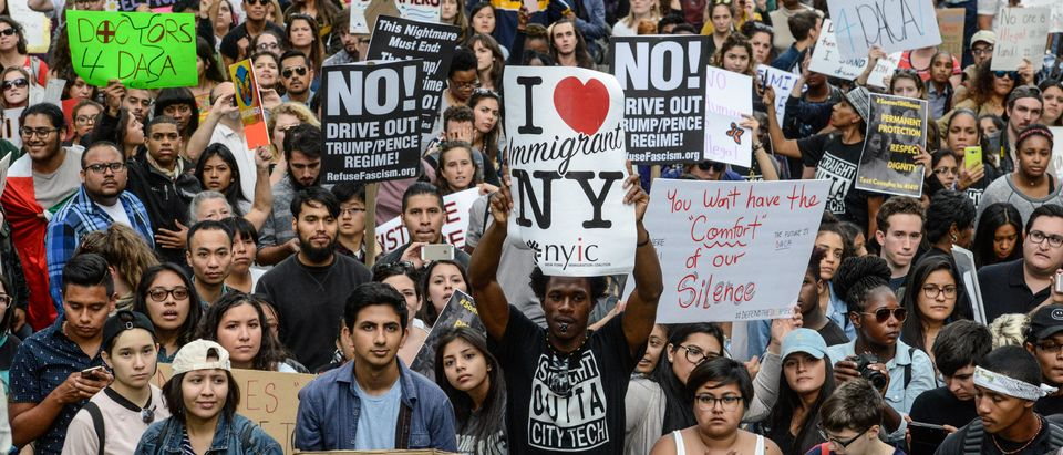 People participate in a protest in defense of the Deferred Action for Childhood Arrivals program or DACA in New York