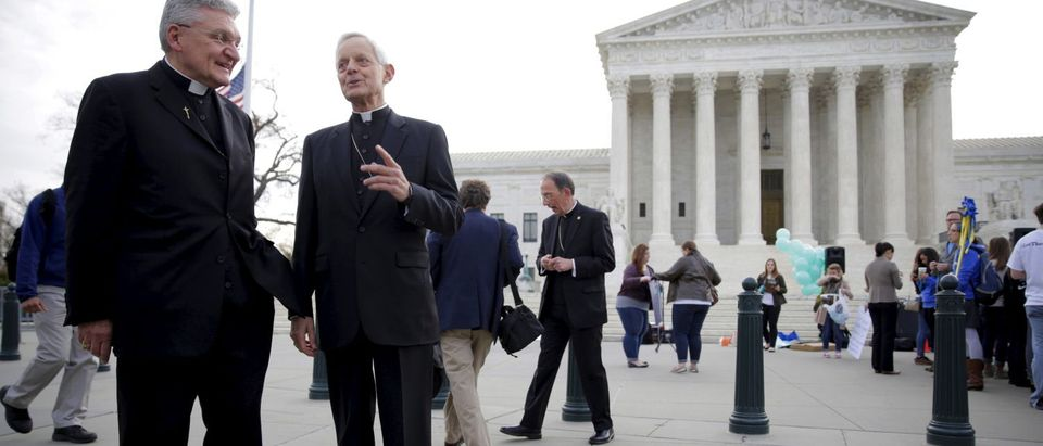 Bishop David Zubik (L) of Pittsburgh and Cardinal Donald Wuerl of Washington speak before before Zubik v. Burwell, an appeal brought by Christian groups demanding full exemption from the requirement to provide insurance covering contraception under the Affordable Care Act, is heard by the U.S. Supreme Court in Washington, March 23, 2016. REUTERS/Joshua Roberts