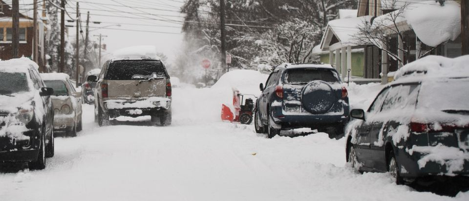 Residents dig out cars after two days of record-breaking snowfall in Erie