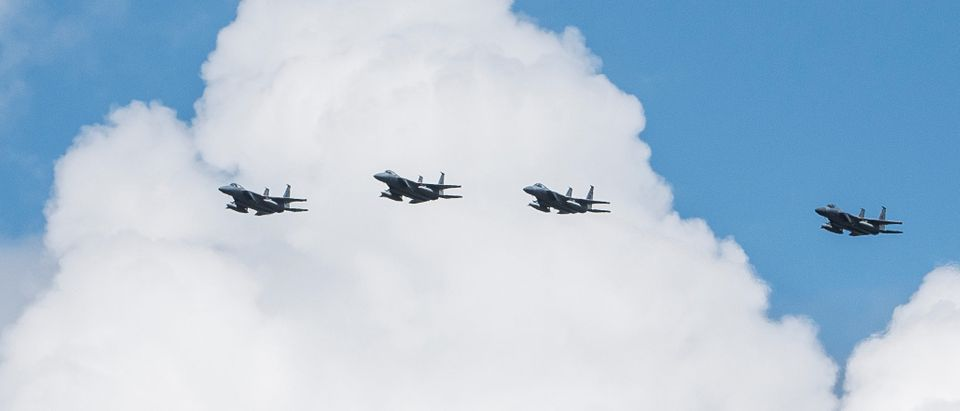 Four F-15C aircrafts circle the runway of Wright-Patterson Air Force Base in preparation for landing as a Safe Haven